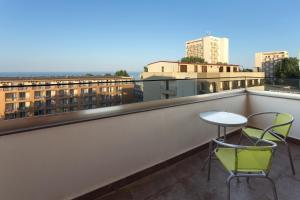 A balcony or terrace at Tomis Garden Aparthotel