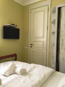 Кровать или кровати в номере Apartment Kutaisi BeBe