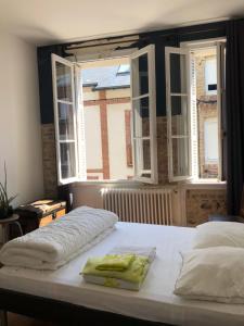 A bed or beds in a room at Belle Maison De Pêcheur Moderne