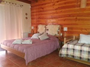 Una cama o camas en una habitación de Monoambiente de Cerro Catedral