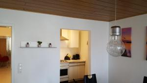 A kitchen or kitchenette at Top Apartment nähe Dom