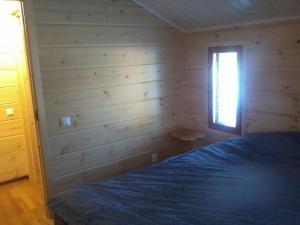 Cama o camas de una habitación en Aamuruskon Ukkola Cottage