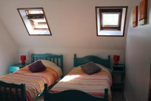 Un ou plusieurs lits dans un hébergement de l'établissement Gite du Nolac
