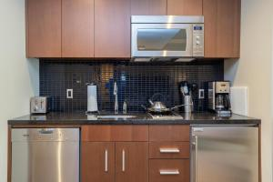 A kitchen or kitchenette at Sutton Place Hotel Revelstoke Mountain Resort