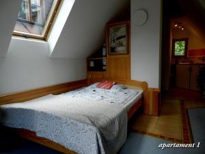 Кровать или кровати в номере Apartamencik z Widokiem Na Giewont