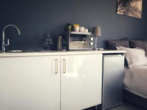 A kitchen or kitchenette at Studio 13 Durban North