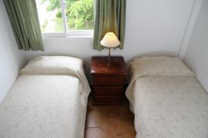 Una cama o camas en una habitación de Amari Suites