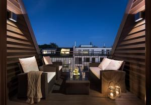 A balcony or terrace at Luxoise Apartments
