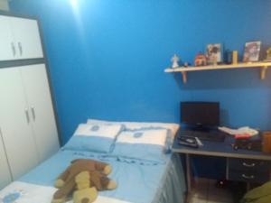 Een bed of bedden in een kamer bij Temporada Cabo Frio