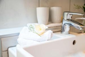 Ein Badezimmer in der Unterkunft 5 Sterne Ferienwohnung am See