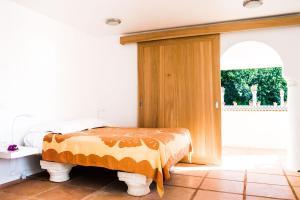 Posteľ alebo postele v izbe v ubytovaní Villa Rea Hanaa