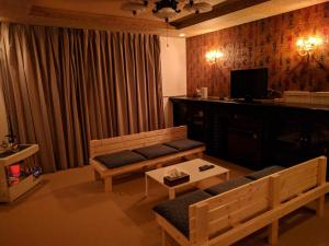 A television and/or entertainment center at Stay@Kushiro
