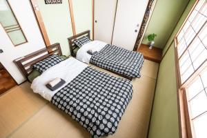 เตียงในห้องที่ Bay House