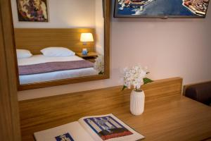 A bed or beds in a room at Porto Platanias Village Resort