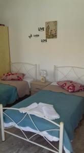Ένα ή περισσότερα κρεβάτια σε δωμάτιο στο Olympia Studios