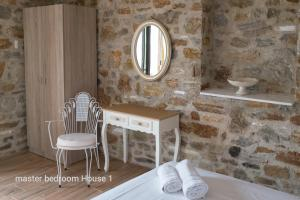 A seating area at Elea Stone Houses in organic quiet olive grove, Prinos, Thassos