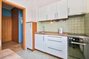 Kuchnia lub aneks kuchenny w obiekcie Apartamencik