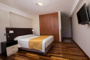 Cama o camas de una habitación en El Sol Cusco Apartments