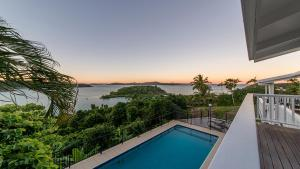 A view of the pool at Pineapple House Whitsundays or nearby