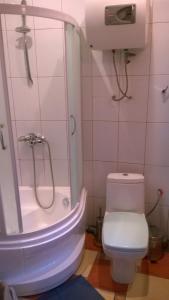 Ванная комната в Лофт-апартаменты с камином