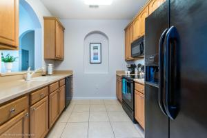 A kitchen or kitchenette at Orlando Comfort