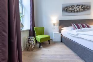 Ein Bett oder Betten in einem Zimmer der Unterkunft Easy Vienna 05