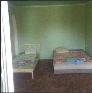 A bed or beds in a room at Апартаменты на Островского,16Б