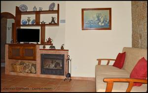 A seating area at Castelo Cottages