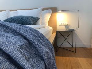 A bed or beds in a room at The Bridge Casa Luxury Apartments
