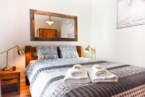 A bed or beds in a room at Apartament Starówka 3