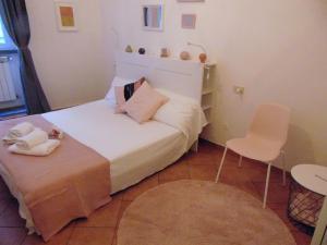 Een bed of bedden in een kamer bij Gessi Charming Apartment