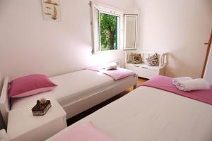Ein Bett oder Betten in einem Zimmer der Unterkunft Vacation House Lavanda
