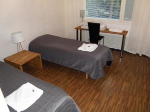 Säng eller sängar i ett rum på Asuntovuokraus Poimu