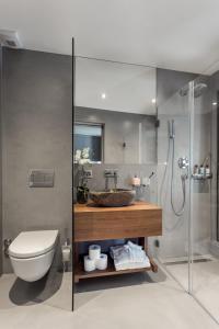 A bathroom at VISIONAPARTMENTS St. Sulpice Route de Vallaire