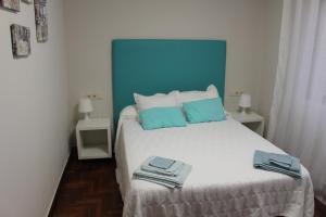 เตียงในห้องที่ En el Corazón de Pontevedra