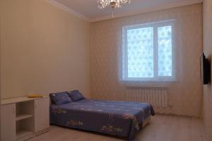Кровать или кровати в номере Apartment Senator