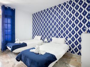 Cama o camas de una habitación en The Pier III Tenerife Holidays