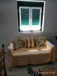 A seating area at Casa Rústica II Rua das Flores