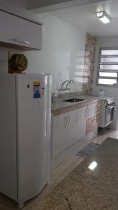 A kitchen or kitchenette at Apartamento Santos