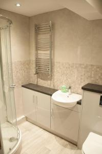 A bathroom at The Square Guest Apartment
