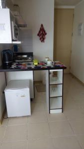 Una cocina o zona de cocina en Departamento Sol de Independencia