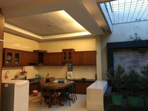A kitchen or kitchenette at U-Nice Residence,15 beds ENTIRE HOUSE,city central Jogja