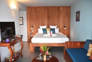 Ein Bett oder Betten in einem Zimmer der Unterkunft Le Panoramic
