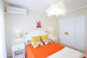 A bed or beds in a room at Beach Design Apartment