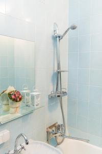 Ванная комната в Apartments Faraon on Gorkogo
