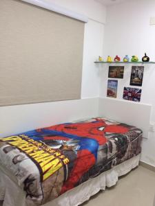 A bed or beds in a room at Apartamento Excelente