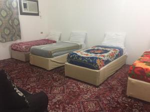 A bed or beds in a room at Jar Al Habib Suites