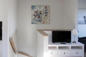 TV/Unterhaltungsangebot in der Unterkunft Haus an den Salzwiesen - Wohnung Sturmmöwe
