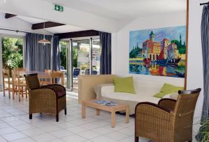 Гостиная зона в Résidence Odalys Primavéra