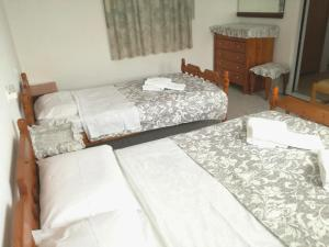"""A bed or beds in a room at 160 m2 village house """"Arkadi"""""""